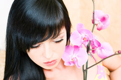 Asian girl with orchid Royalty Free Stock Photography