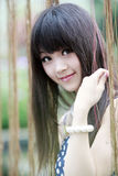 Asian girl outdoor portrait. Beautiful Asian girl smiling outdoor portrait Royalty Free Stock Images