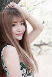 Asian girl outdoor portrait. Charming Chinese girl with long hair outdoor portrait Royalty Free Stock Photo