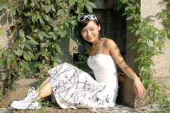 Asian girl outdoors. A beautiful asian girl is in the portrait outdoors Royalty Free Stock Images