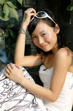 Asian girl outdoors. A beautiful asian girl is in the portrait outdoors Royalty Free Stock Photos