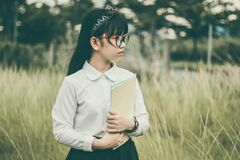 Asian girl outdoors holding folder Stock Photo