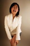 Asian girl in pain. Asian girl feeling lots of pain in her leg Stock Photos