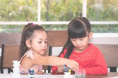 Asian girl painting a doll in Art classroom. Asian girl is painting a doll in Art classroom stock photography