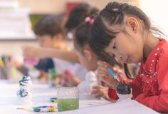 Asian girl painting on paper in Art group Royalty Free Stock Photography