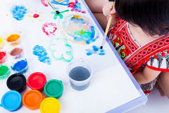 Asian girl painting and using drawing instruments, creativity co Royalty Free Stock Photos