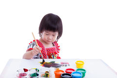 Asian girl painting and using drawing instruments Royalty Free Stock Photo