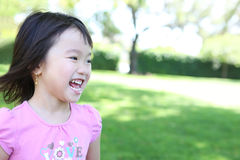 Asian Girl in Park Stock Photography