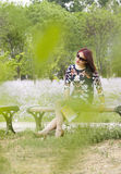 An Asian girl in the park Royalty Free Stock Images