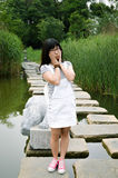 Asian girl on the path. Outdoor portrait girl in the lake path, teenage asian girl with a smile Stock Photo