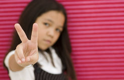 Asian Girl and Peace Sign Stock Photos