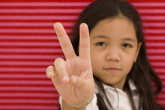 Asian Girl and Peace Sign Stock Images