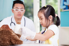 Asian girl at pediatrician's office Stock Images