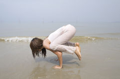 Asian girl performing yoga Royalty Free Stock Photo