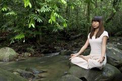 Asian girl performing yoga Royalty Free Stock Photos