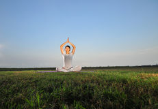Asian Girl performing Yoga on grass/ park Stock Image