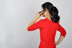 An Asian girl on the phone Royalty Free Stock Photography