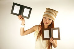 Asian girl with photo frames Royalty Free Stock Photography