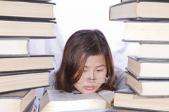 Asian girl in pile of books. On white background Stock Photo