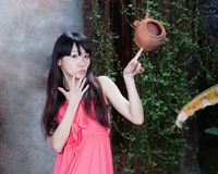 Asian girl by plants Royalty Free Stock Image
