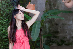 Asian girl by plants Royalty Free Stock Photos