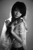 Asian girl in a plastic bag Stock Images