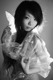 Asian girl in a plastic bag. Asian girl wearing a plastic bag to protect herself Royalty Free Stock Image