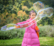 Asian girl play a bubble Royalty Free Stock Photography