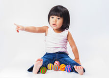 Asian girl play colour ball. Portrait mini smile asian girl point and play color ball in isololate stock images