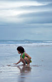 Asian girl playing alone on the big ocean shore Royalty Free Stock Image