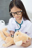 Asian girl playing as a doctor Stock Images