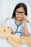Asian girl playing as a doctor Royalty Free Stock Photo