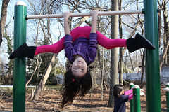 Asian girl playing on bars Royalty Free Stock Photo
