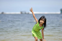 Asian girl playing on the beach in the summertime Stock Image