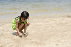 Asian girl playing on the beach in the summertime Stock Photo