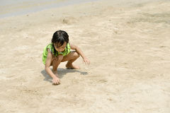 Asian girl playing on the beach in the summertime Stock Photography