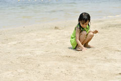 Asian girl playing on the beach in the summertime. Asian girl playing on the beach Stock Images