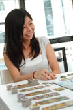 Asian girl playing a board game Stock Photo