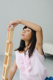 Asian girl playing building block at home Royalty Free Stock Image