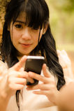 Asian girl playing cell phone Royalty Free Stock Photo