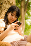 Asian girl playing cell phone Stock Photos