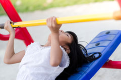 Asian girl playing fitness equipment outdoor. stock image