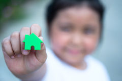 Asian girl playing house model, select focus. Royalty Free Stock Photography