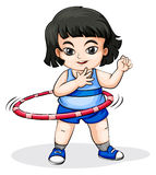 An Asian girl playing with the hulahoop Royalty Free Stock Photography