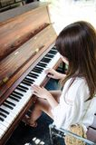 Asian girl playing piano stock images