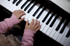 Asian girl playing the piano at home Stock Photo