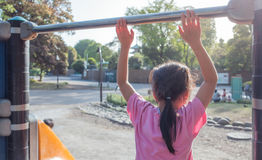 Asian girl is playing in playground in park Royalty Free Stock Photos