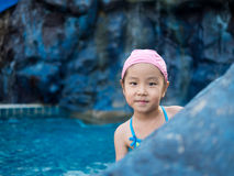 Asian girl is playing in the pool Royalty Free Stock Image