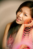 Asian girl playing slinky Stock Photo
