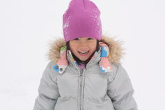 Asian Girl Playing in Snow royalty free stock photography